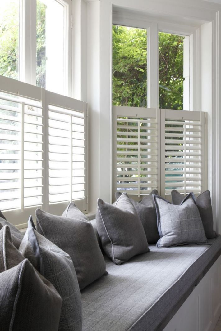 Want to create a window seat in your bay window? Shutters are ..