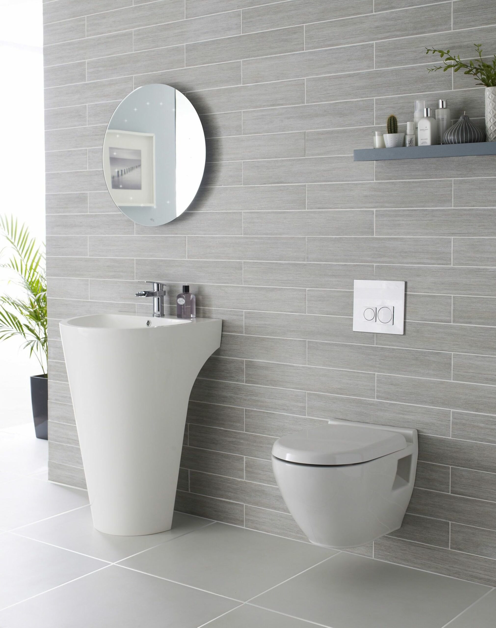 We adore this white and grey bathroom complete with Lavish basin ..