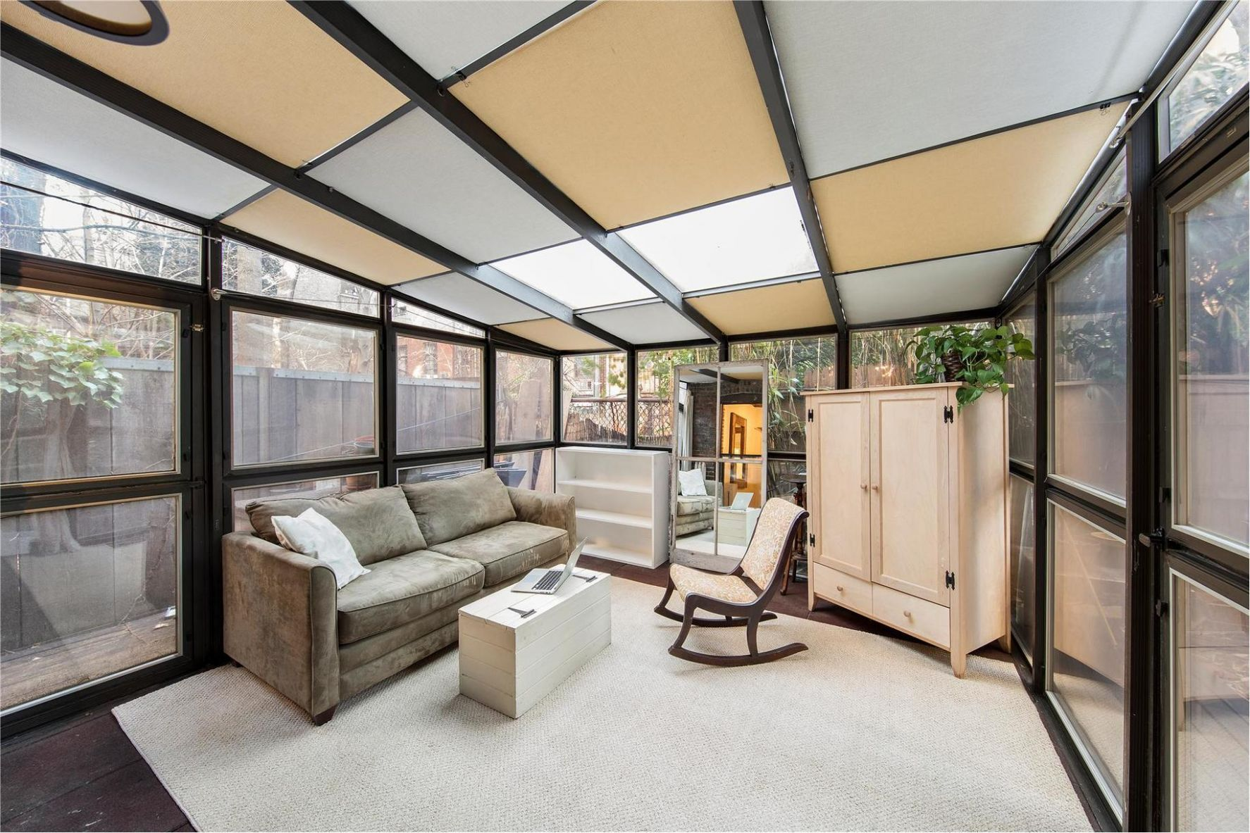 With a Cool Renovation and a Sunroom, This Tiny East Village Home ...