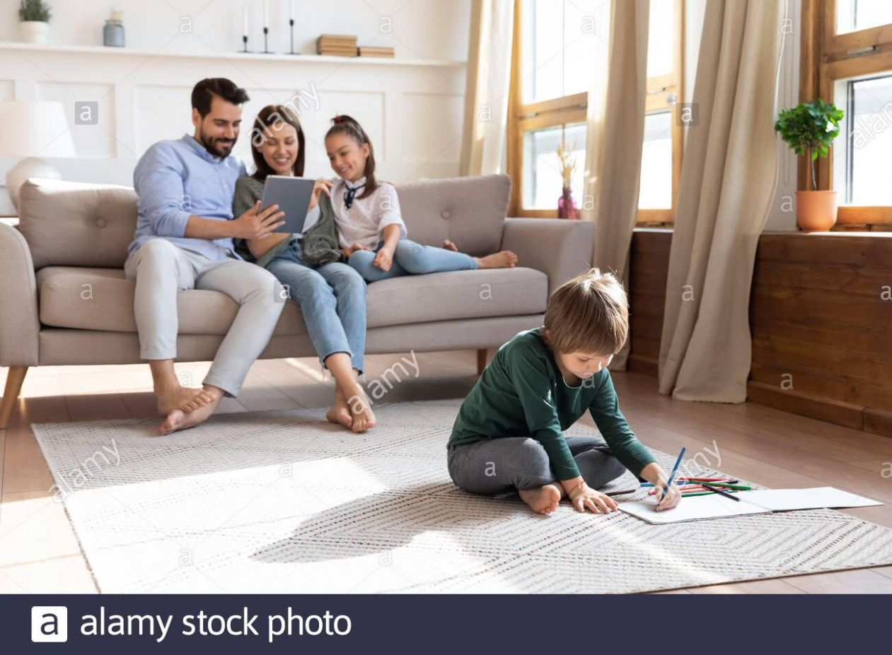 Young family with small kids relax in living room Stock Photo ..