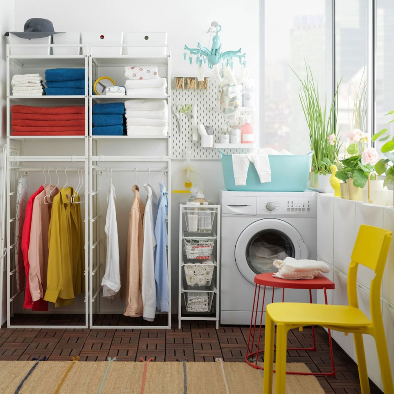 Affordable laundry room with JONAXEL shelving unit - IKEA