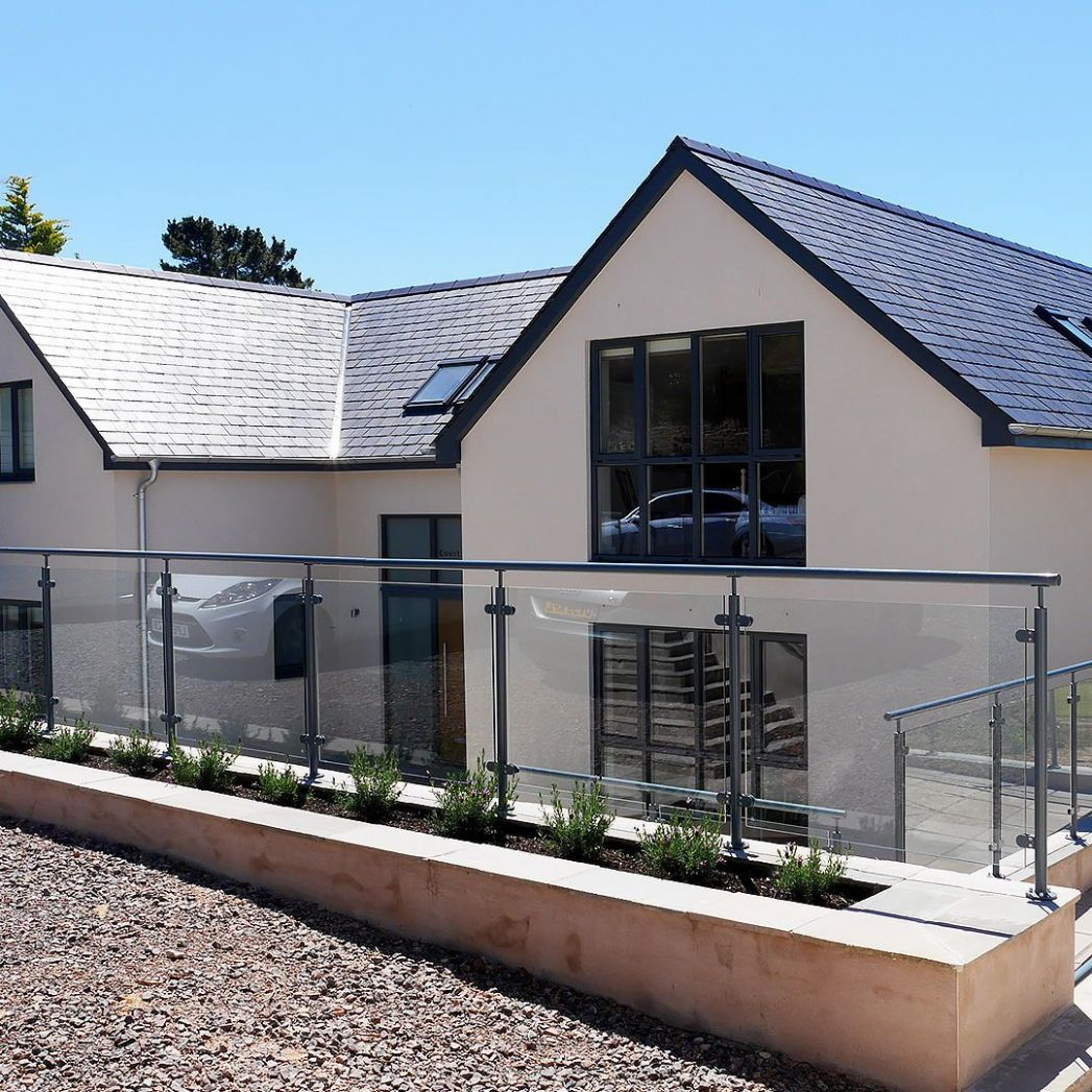 Back Exterior, White render with grey window and doors ...