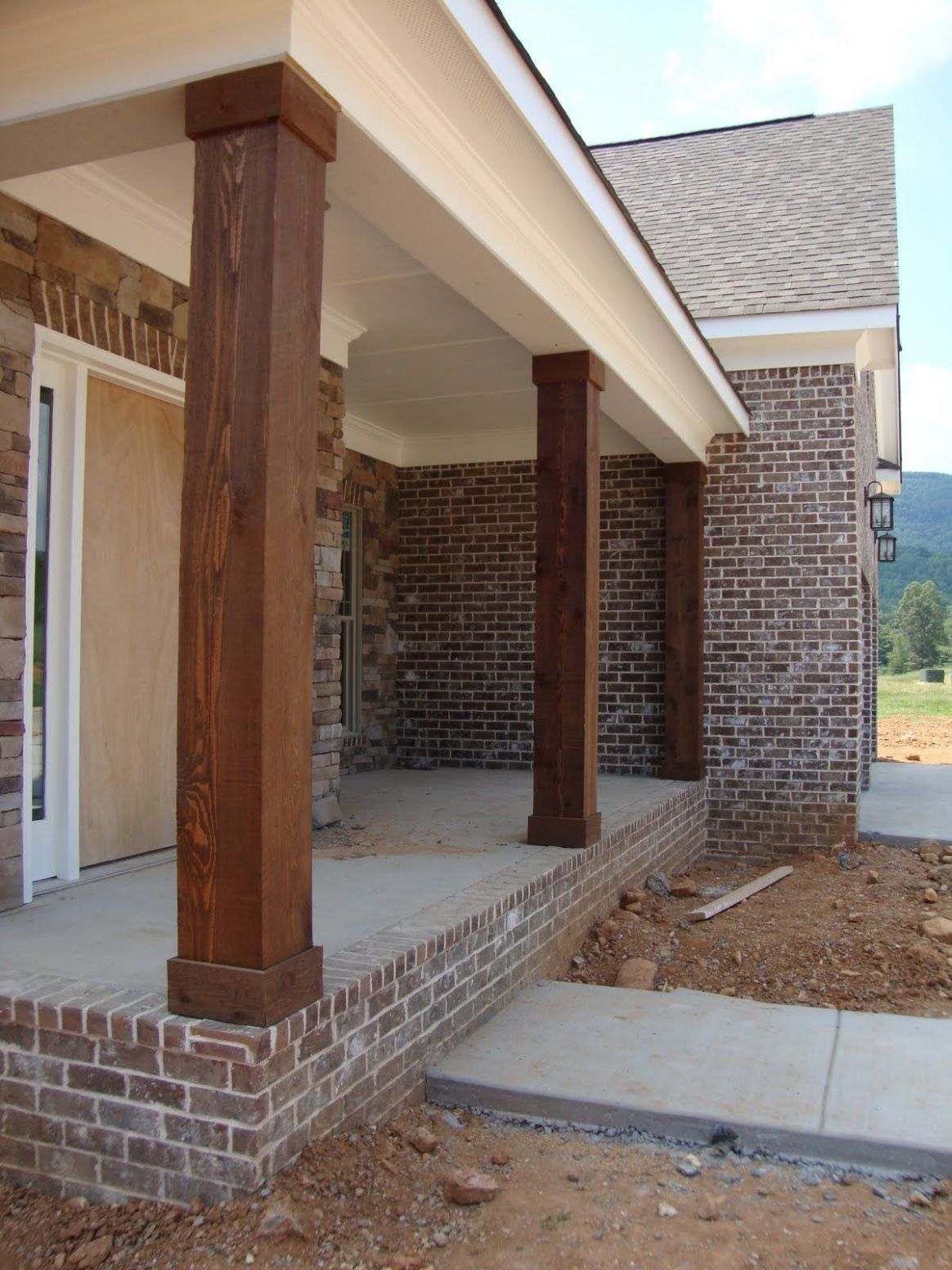 Cedar Columns, Lighting, and Stained Stairs   House exterior ..