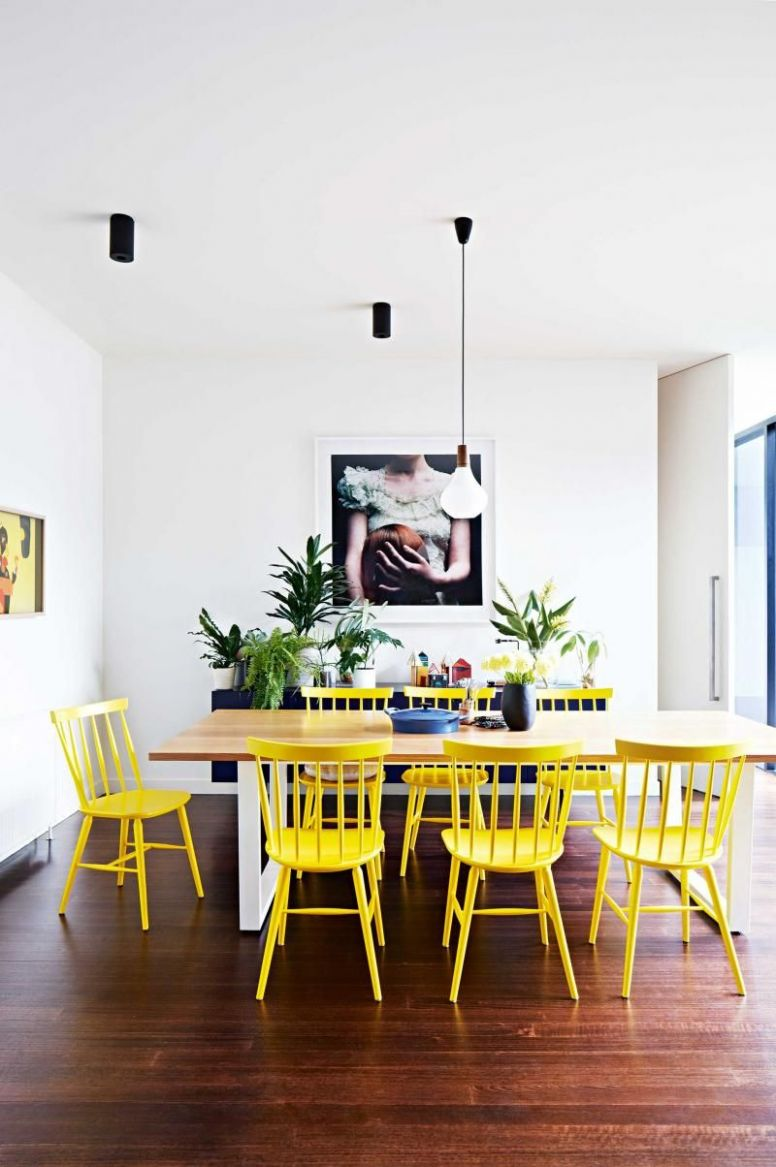 Dining room: bright yellow Ercol chairs, wooden rectangular dining ..