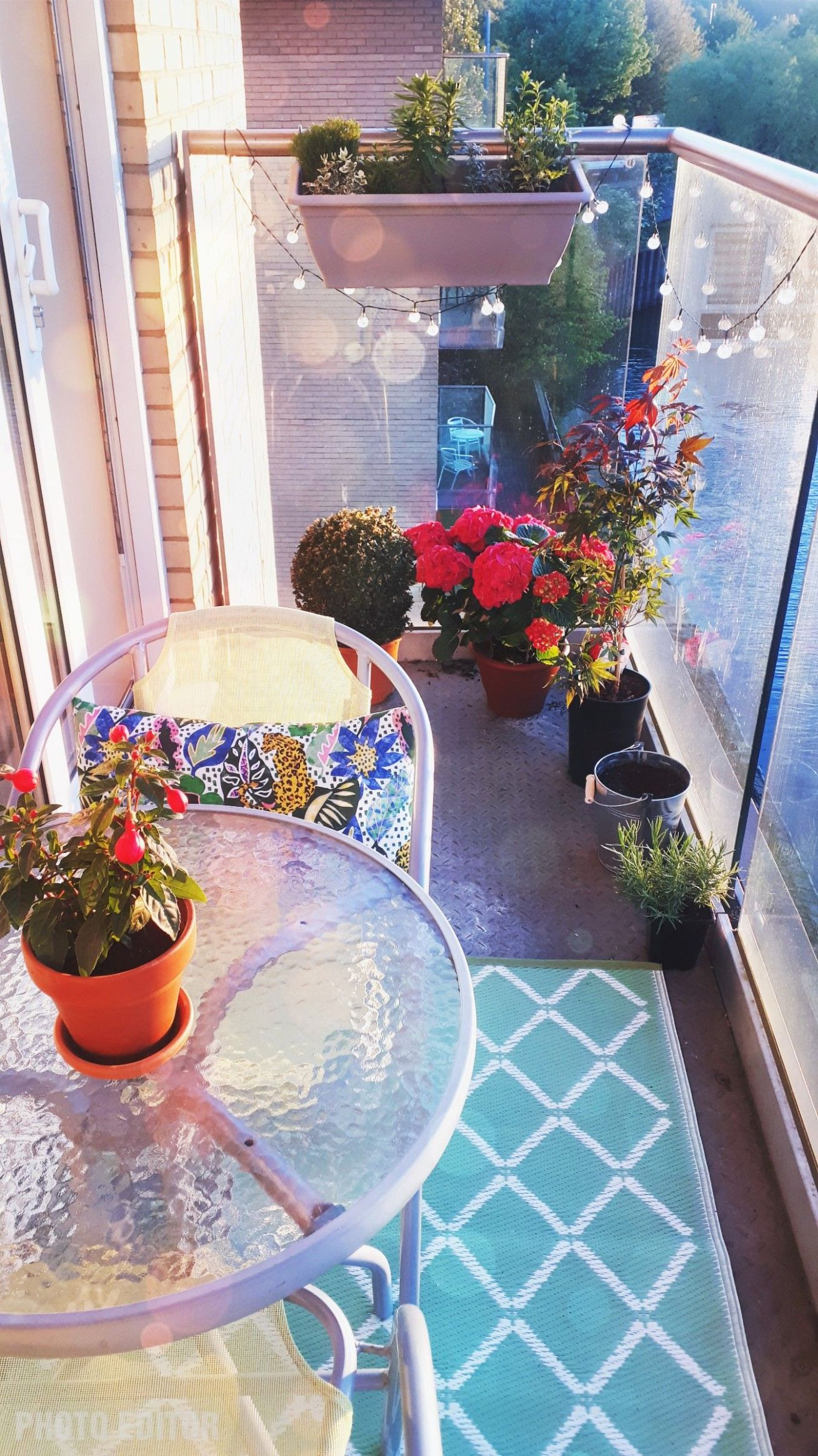 Don't be afraid to add colour and plants to your apartment balcony ...