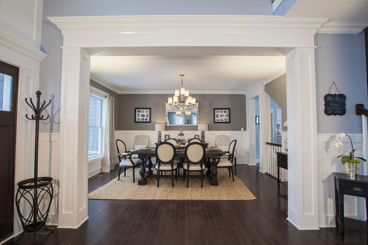 Exquisite molding creates a grand entrance into the dining room of ..