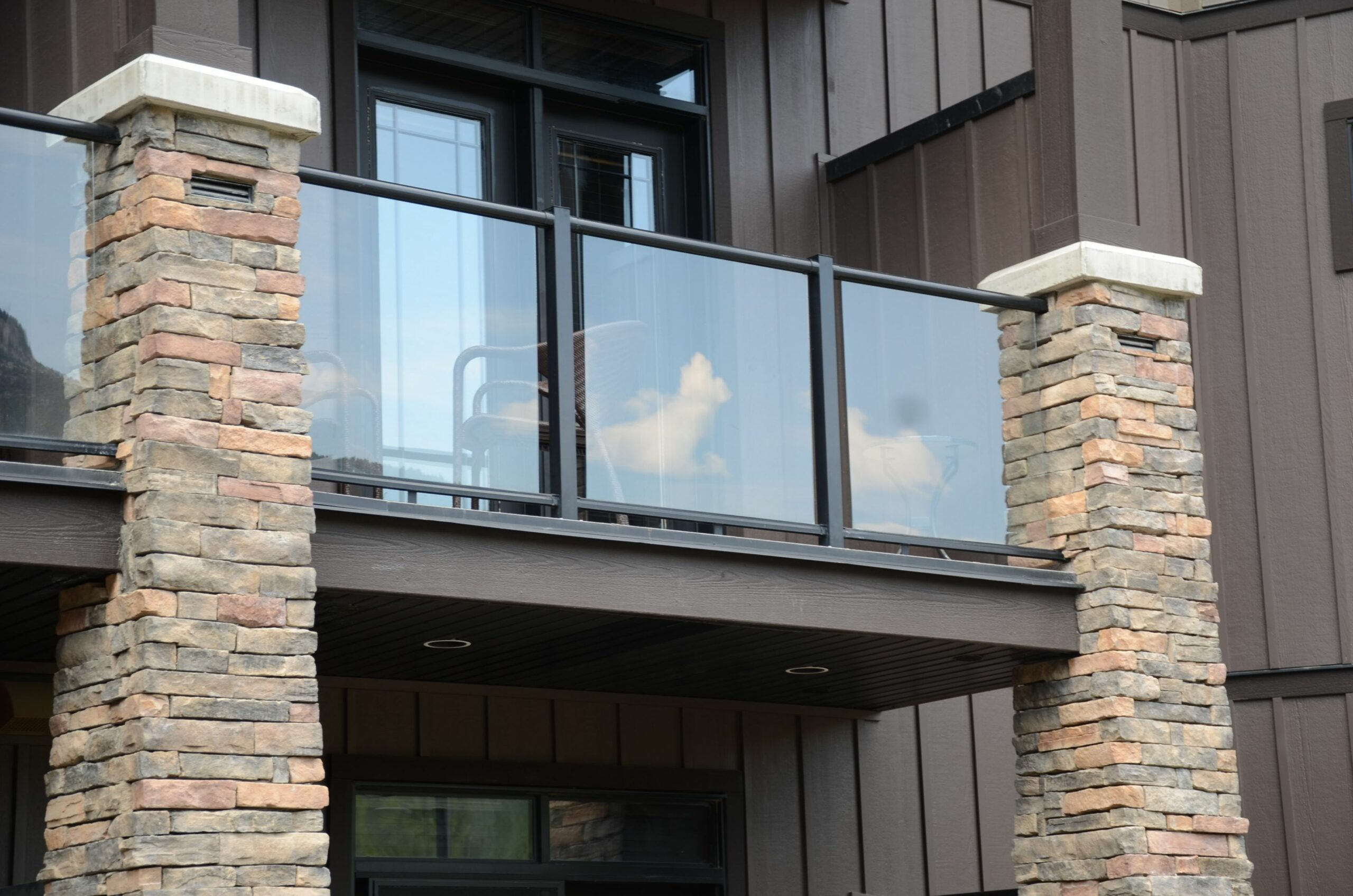 Glass railing balcony with stone pillars | Glass balcony, Balcony ..
