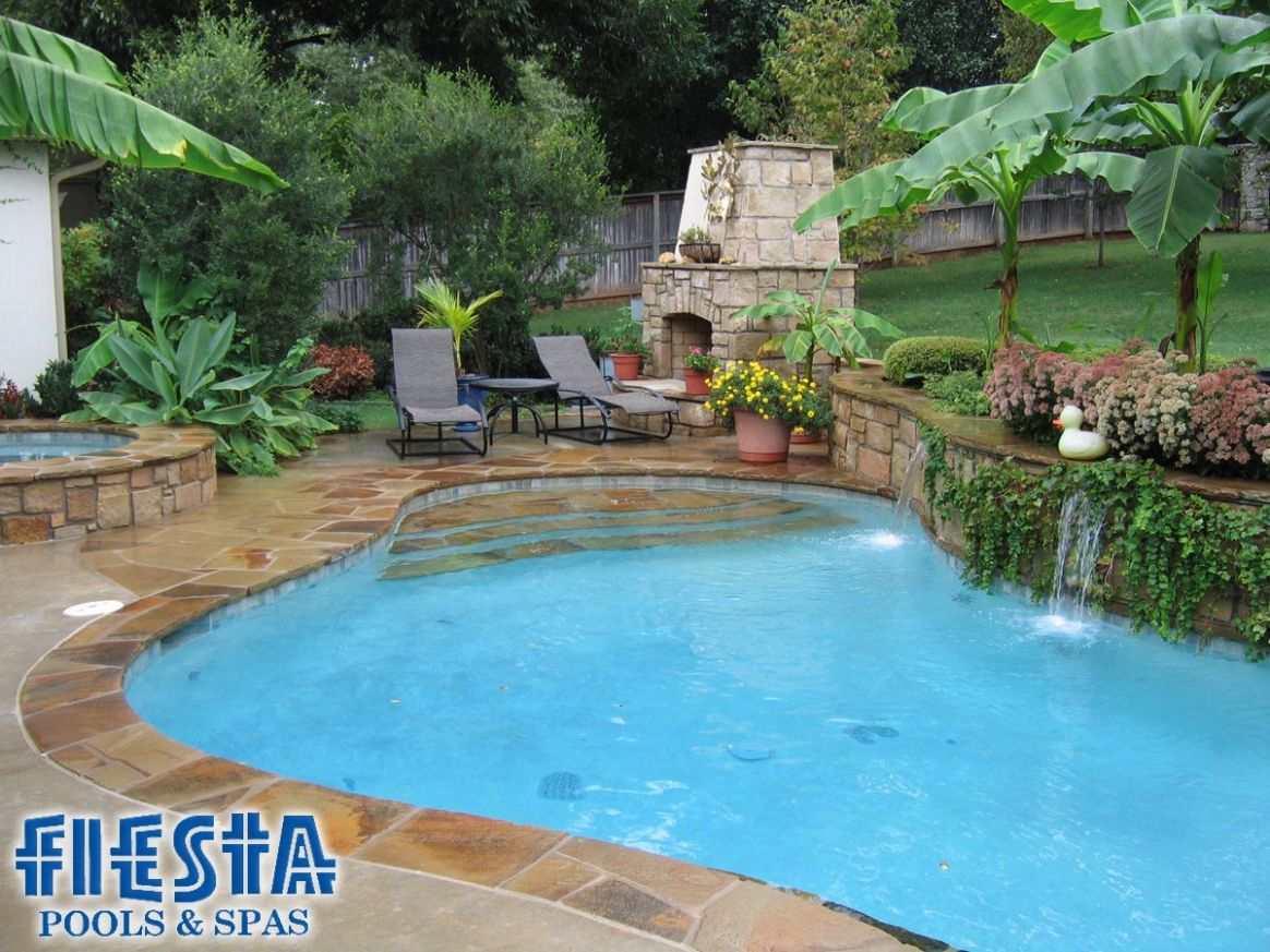 in ground pool with waterfall on retaining wall slope | Pool ...