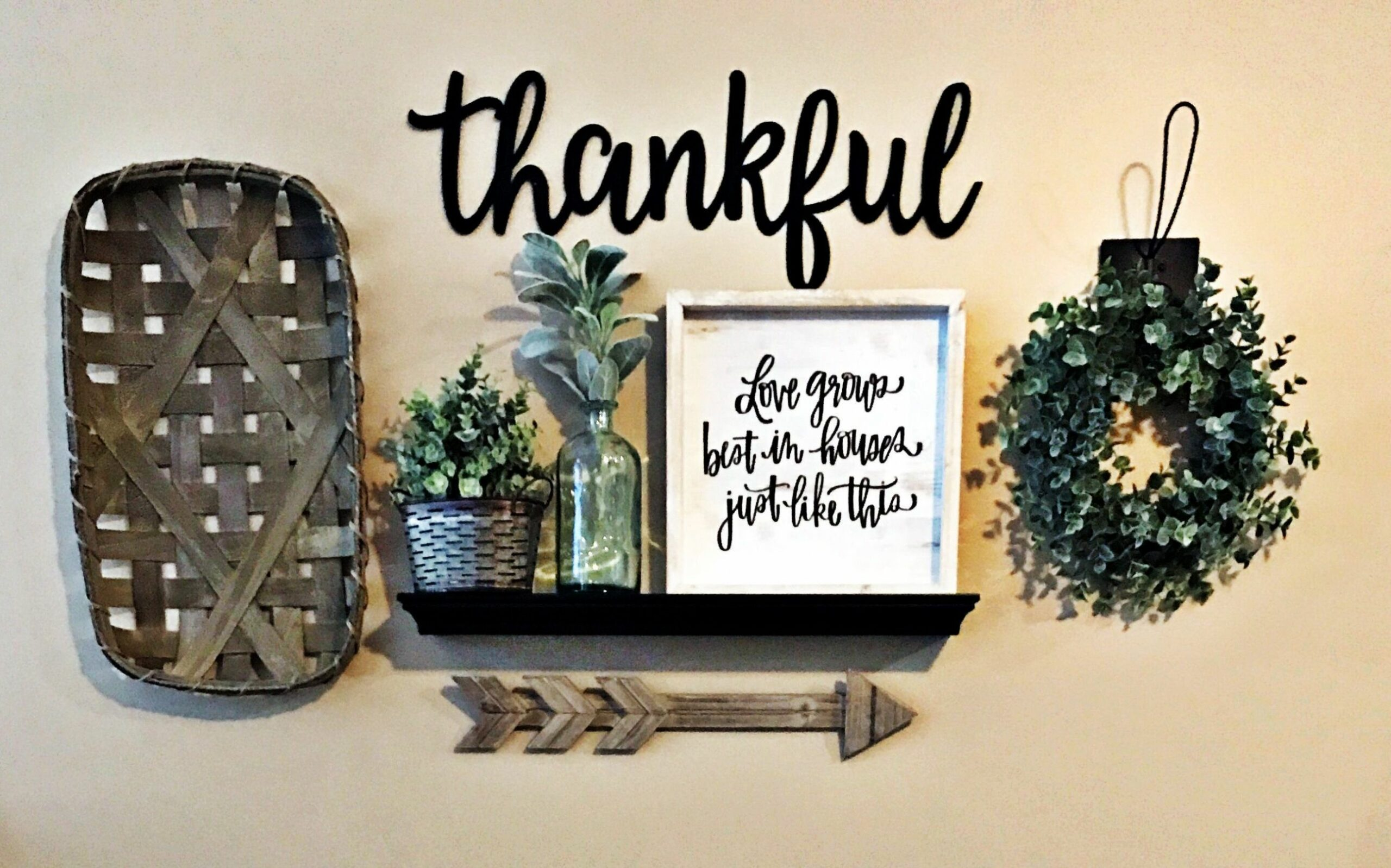 Living room gallery wall using farmhouse decor from Hobby Lobby ..