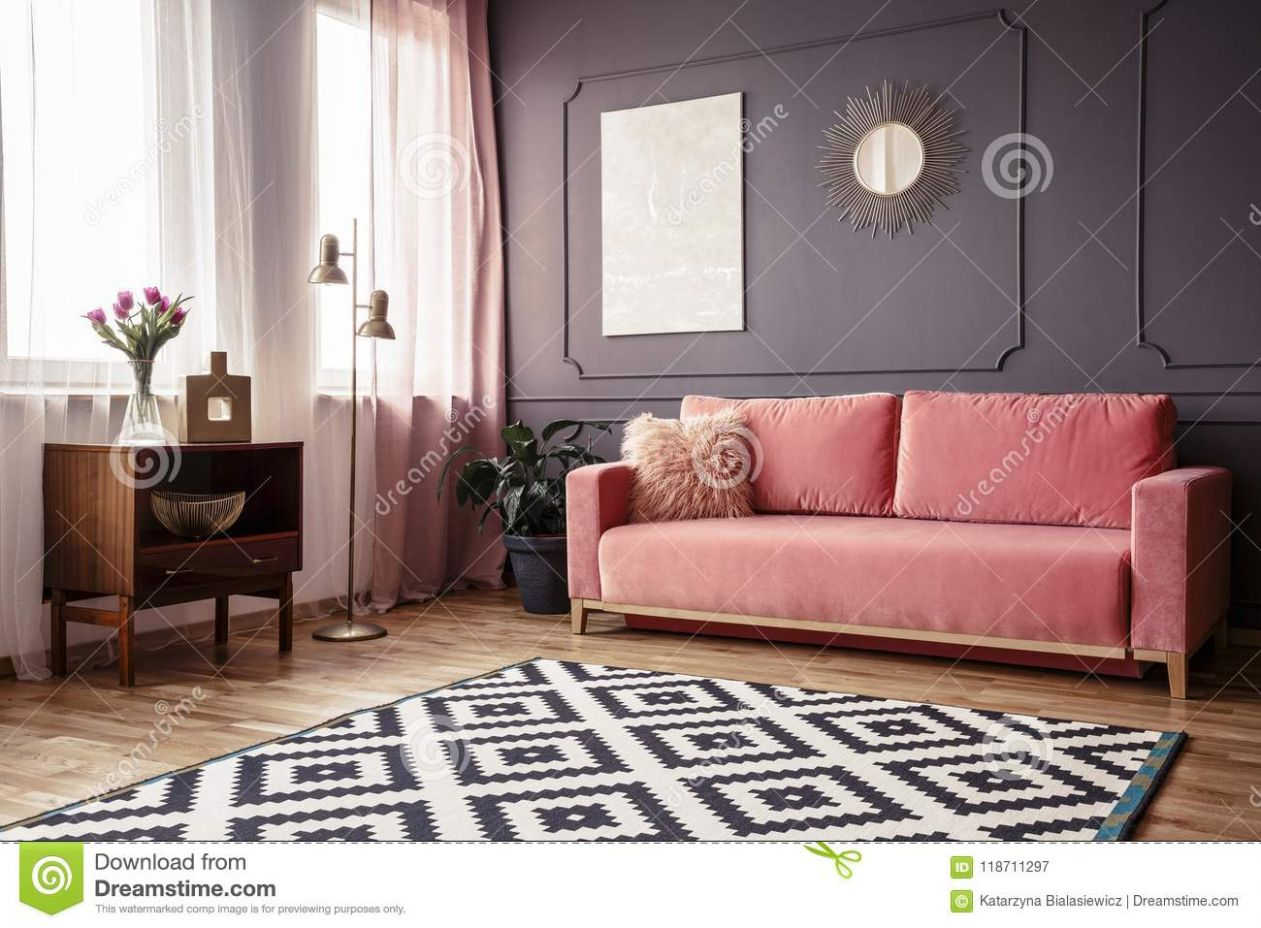Side Angle Of A Living Room Interior With A Powder Pink Sofa, Pa ..
