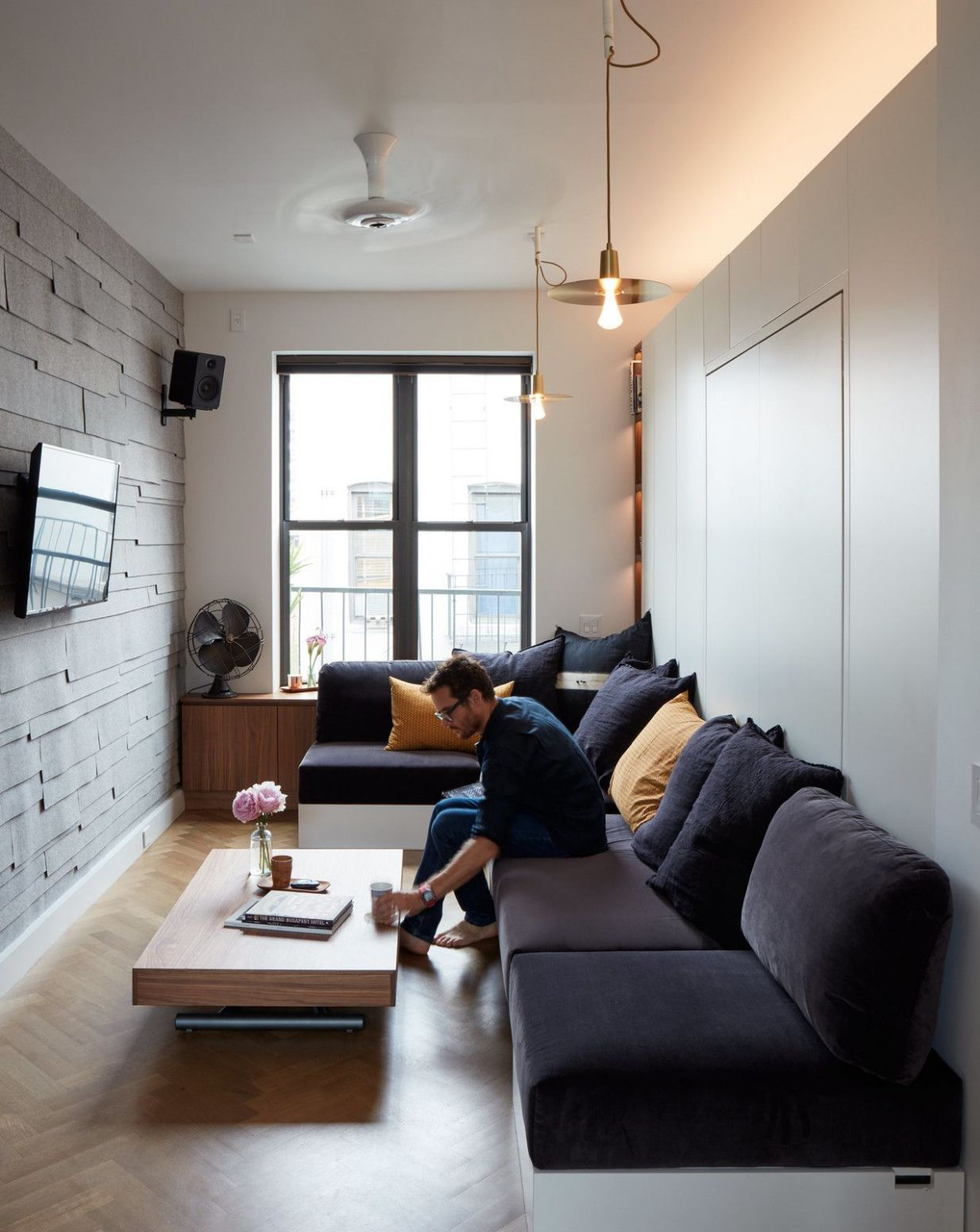Small Space Living in a SoHo Apartment | Narrow living room, Small ...