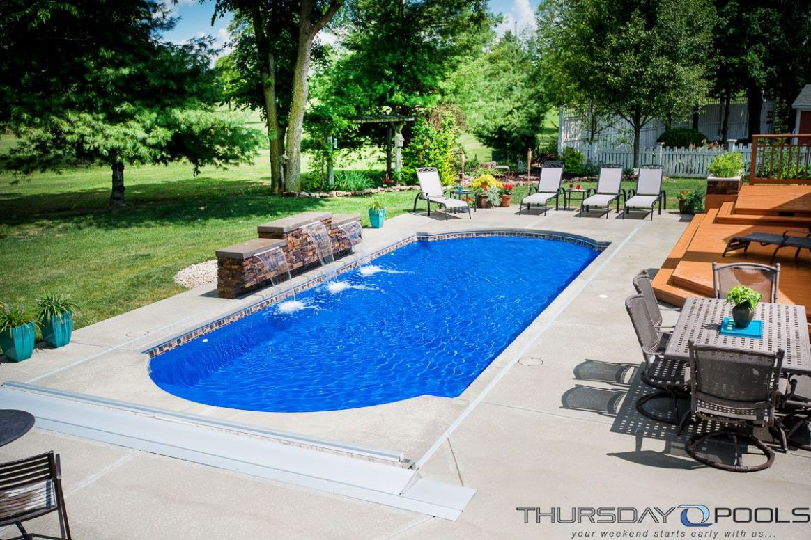 This backyard has a Cathedral fiberglass pool design by Thursday ...
