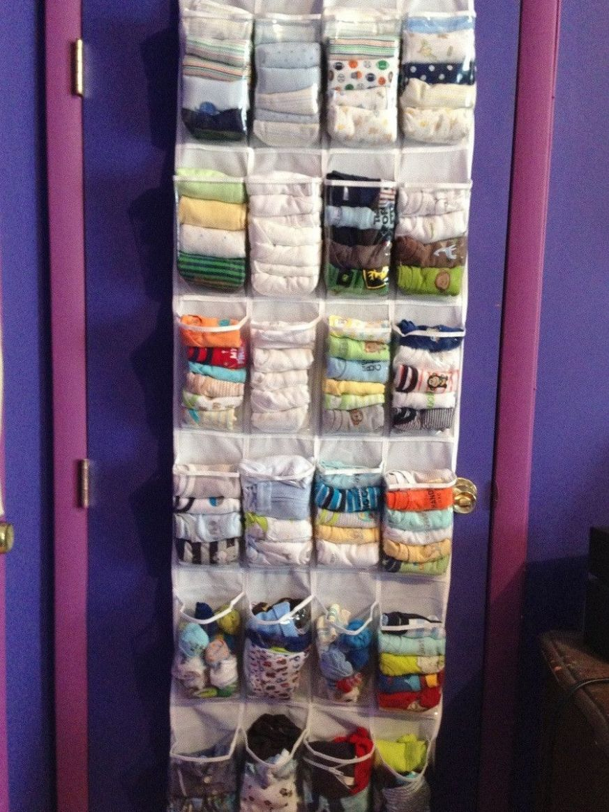 Use a shoe organizer to store onesies, bibs, baby shoes, socks ..