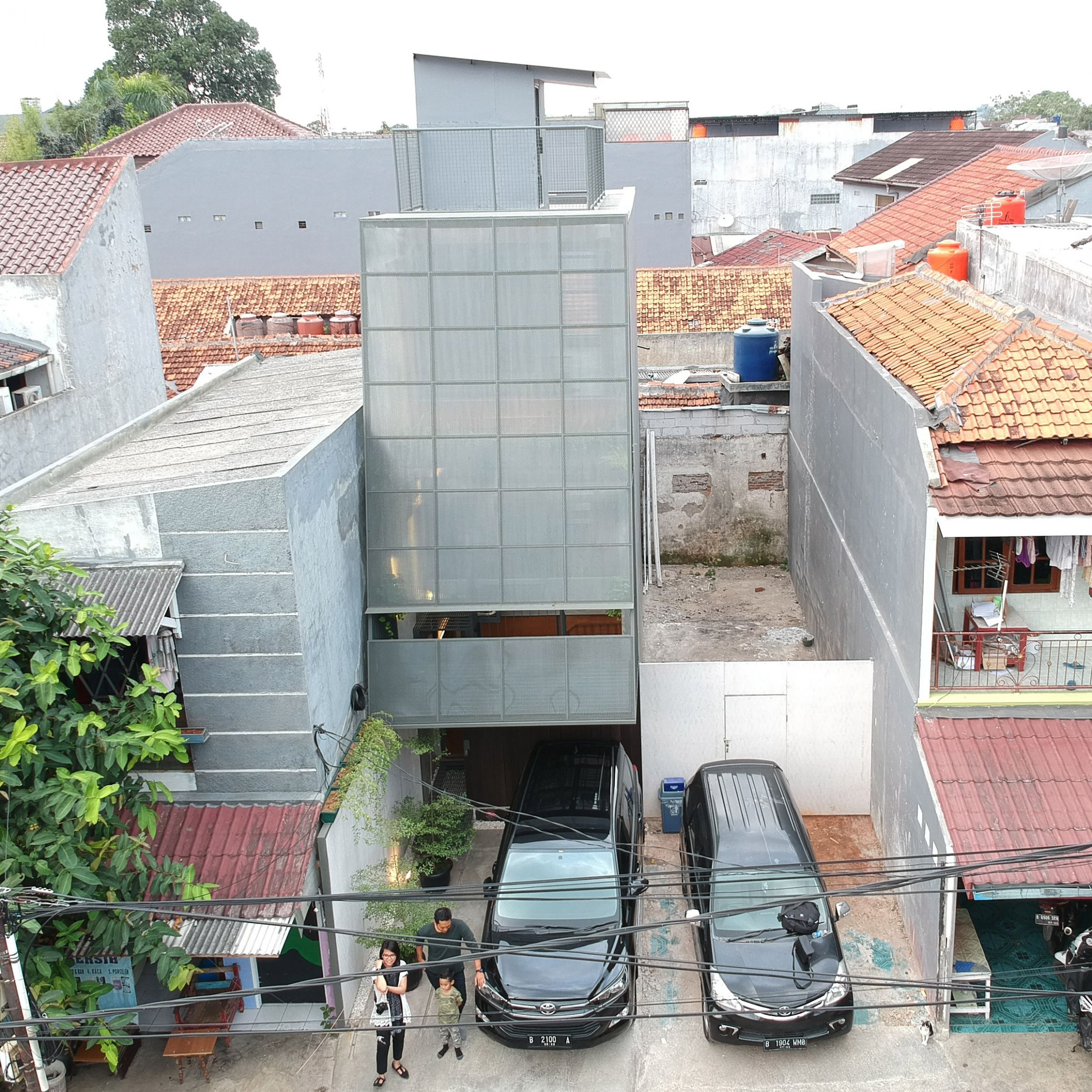 11,11 Millimetre House is a skinny house in Indonesia on a 11.11 ...