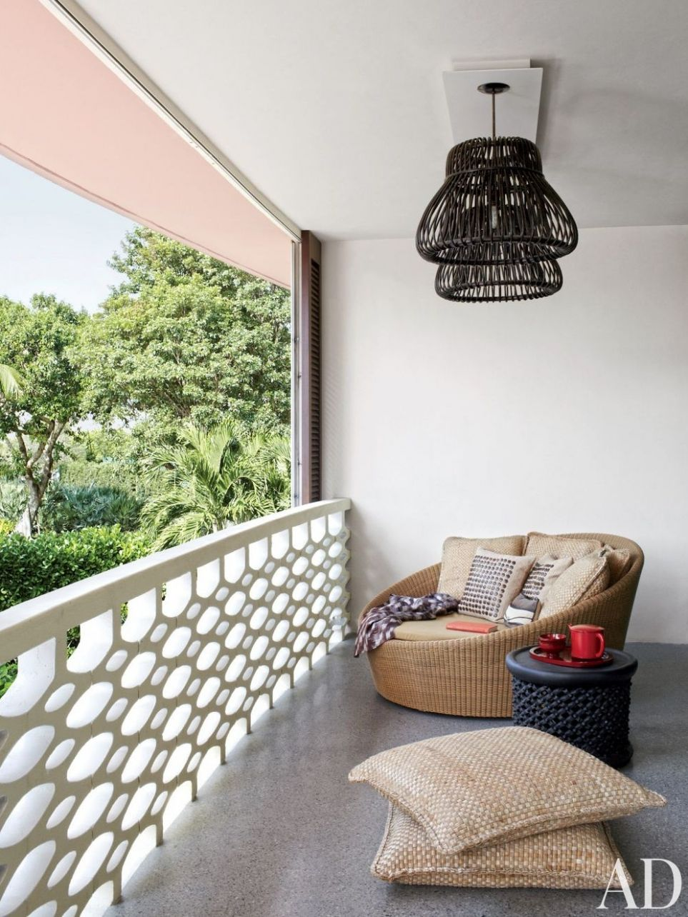 11 Cozy Balcony Ideas and Decor Inspiration | Architectural Digest - balcony sit out ideas