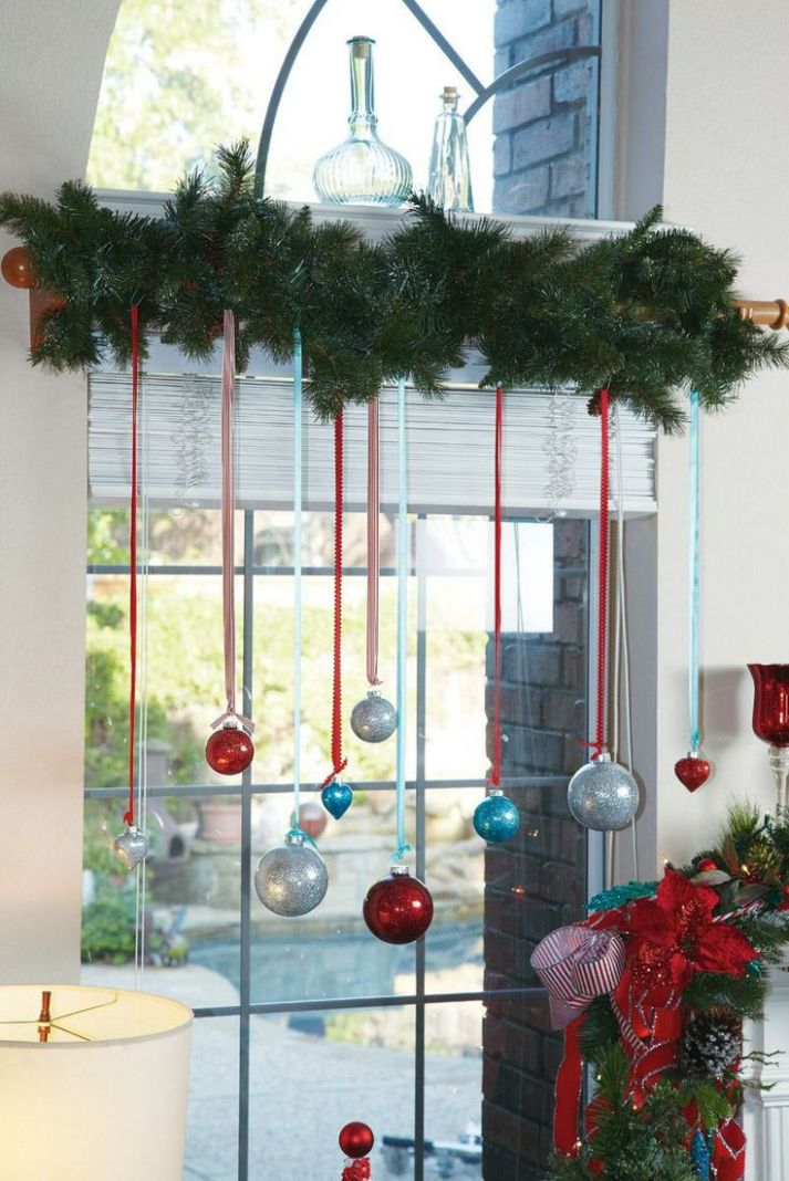 8 Festive Decorations to Hang in Your Windows for the Holidays - window ornament ideas