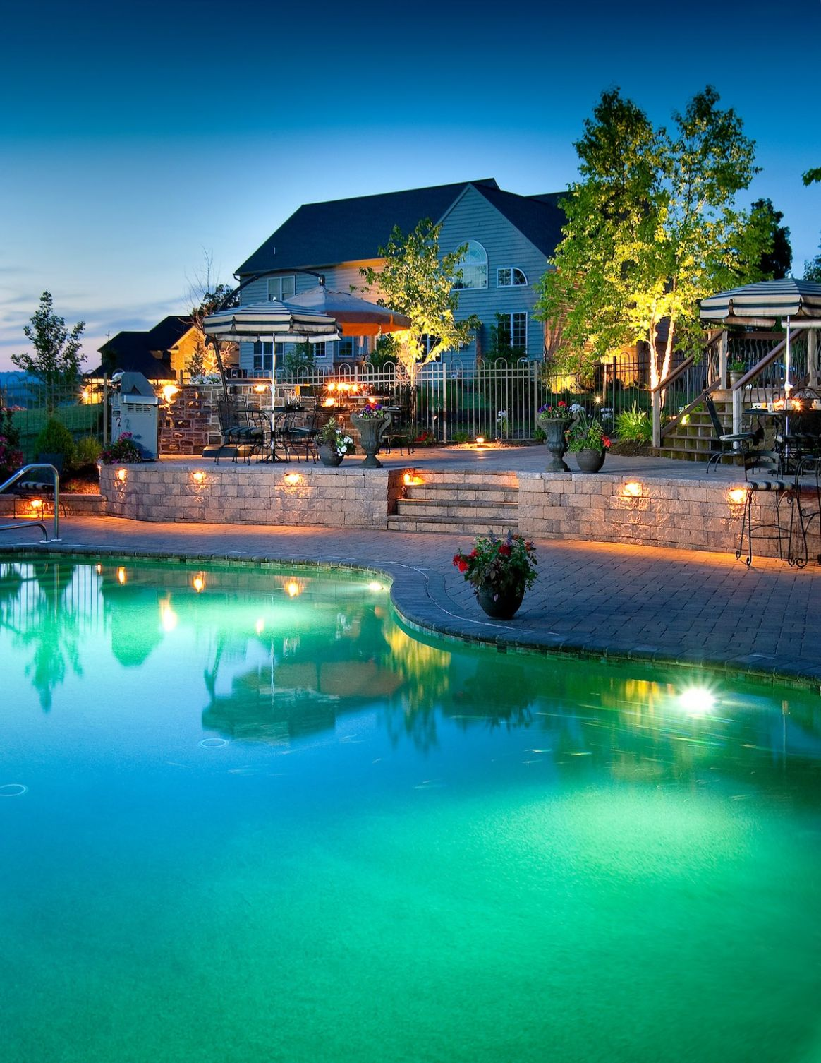9 Great Landscape Lighting Ideas for Trees, Pools, Walkways, and More - pool lighting ideas