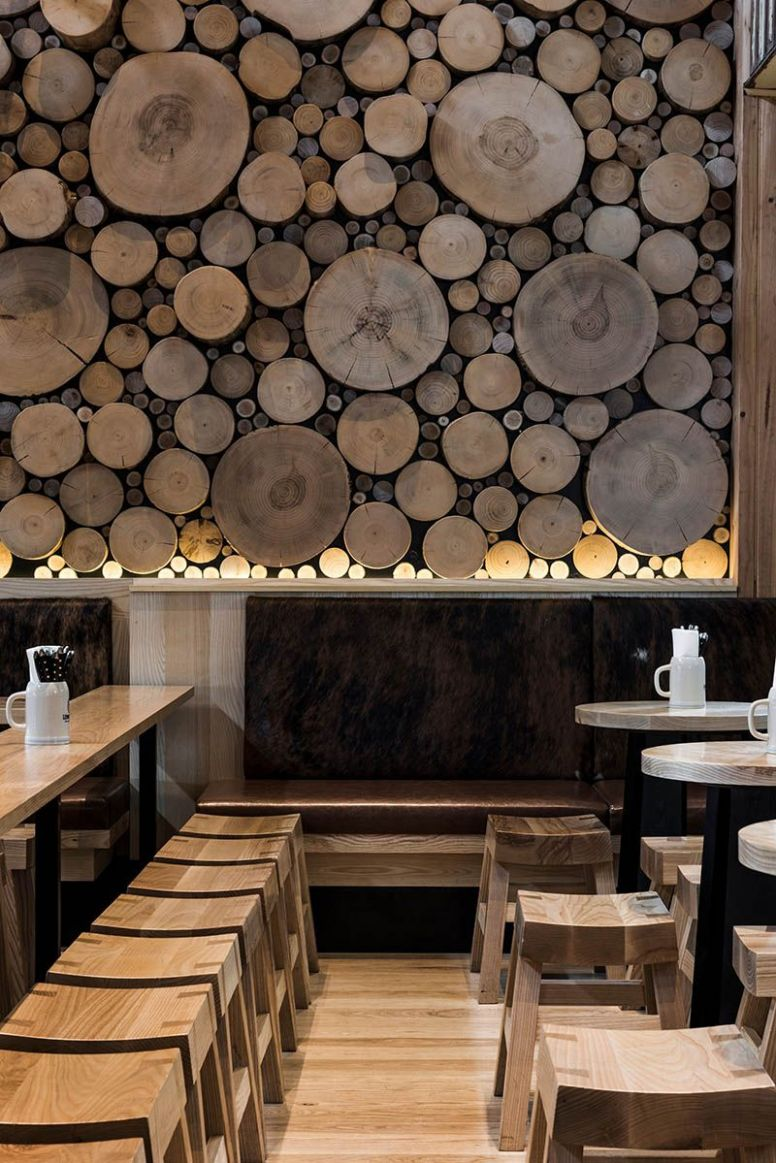 A Giant Log Wall Is A Focal Point In This Restaurant In Australia ...