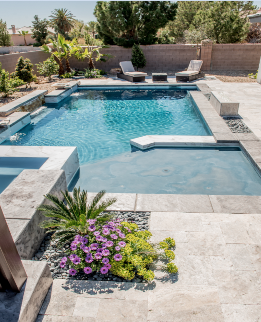 A stunning modern pool with stone accents, sun shelf tanning ledge ...