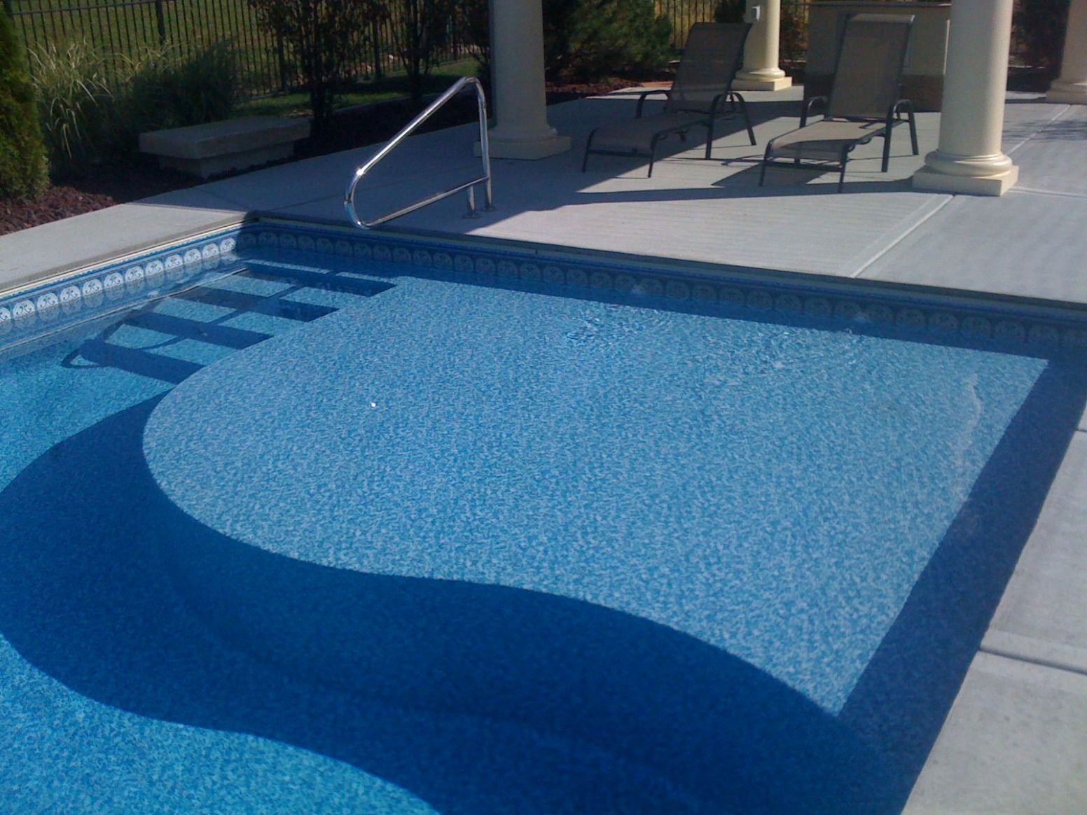A Tanning Ledge in a pool designed and built by Caribbean Pools ...