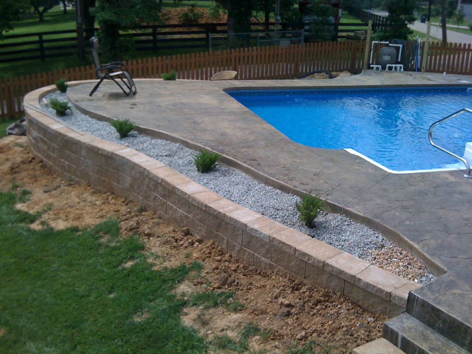 An inground liner pool with a stamped concrete pool deck. (With ...