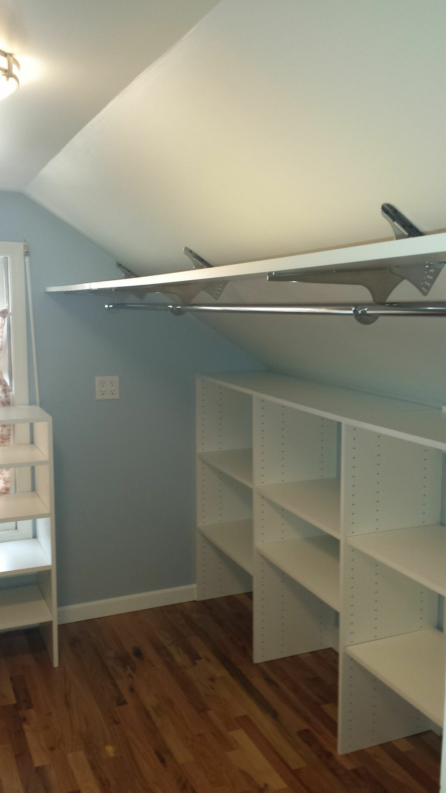 Angled brackets used to maximize space in attic closet. (With ..