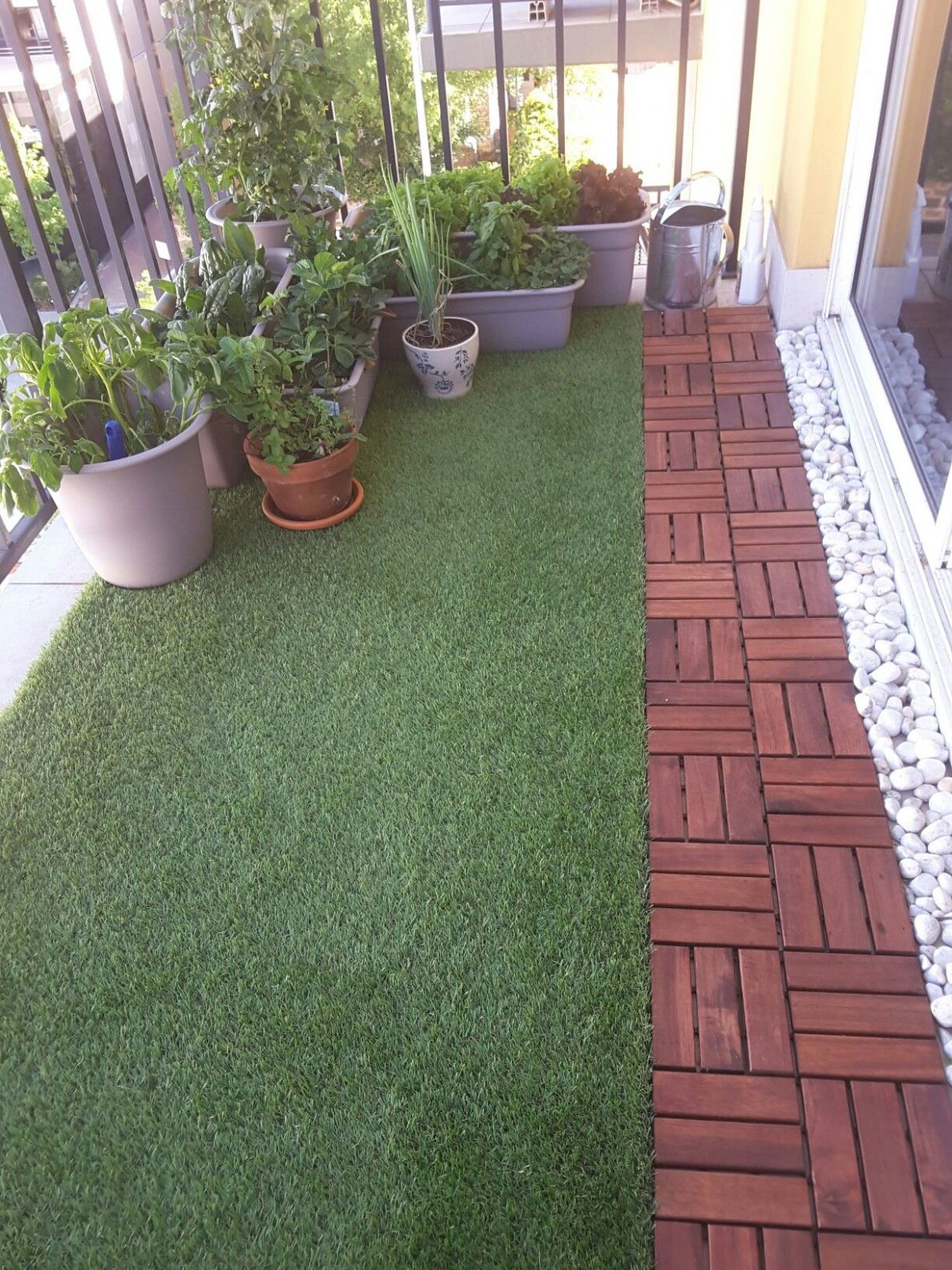 Balcony with artificial grass, decking and plants. (With images ..
