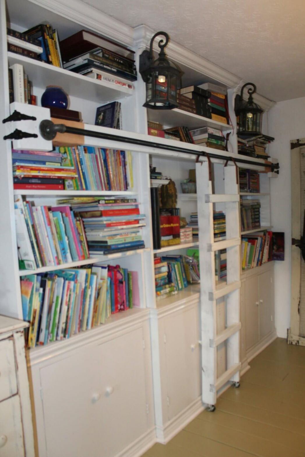 Built-in Shelves with Attached Library Ladder — Homebnc - closet ladder ideas