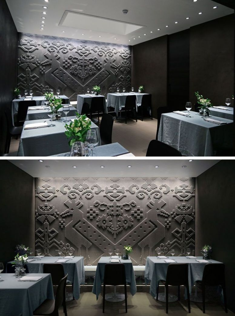 Chiseled Stone Tapestries Cover The Walls Of This Restaurant In ...