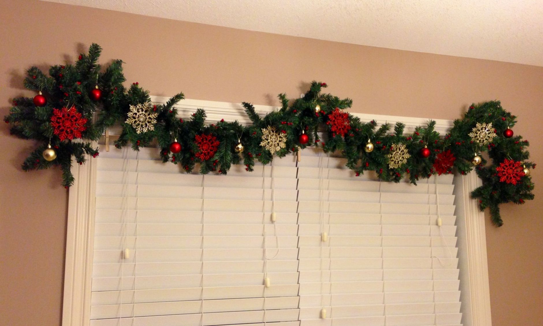 Christmas garland over the dining room window with glitter ..