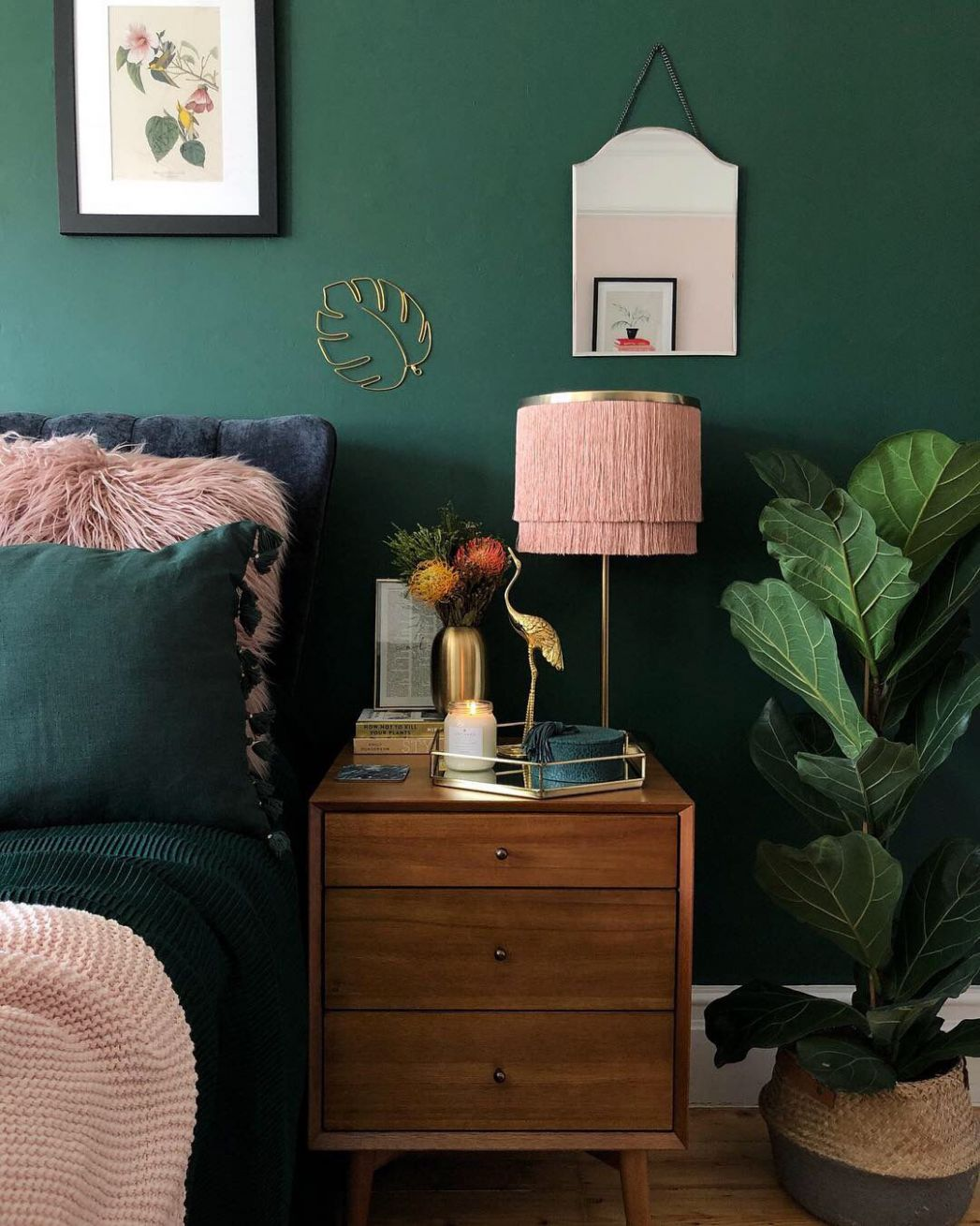 Dark green and blush pink decor in bedroom with mid century twist ..