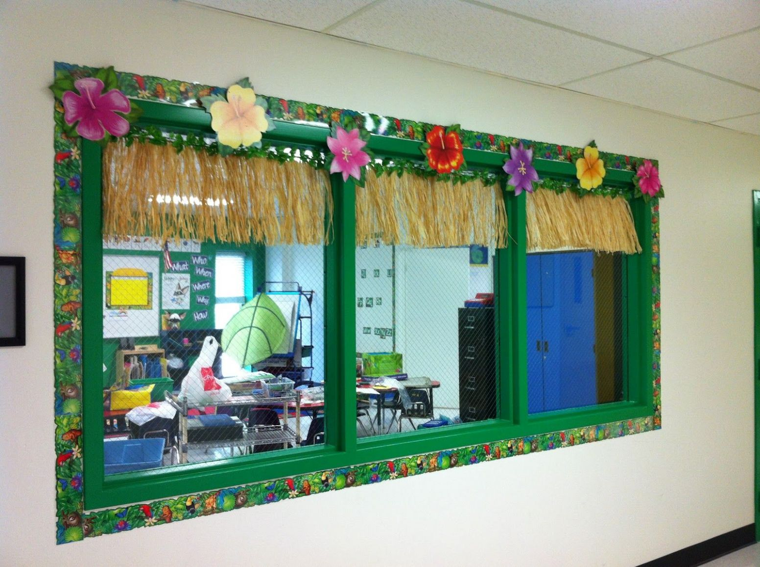 Decorated hallway window looking into the classroom | Jungle theme ..
