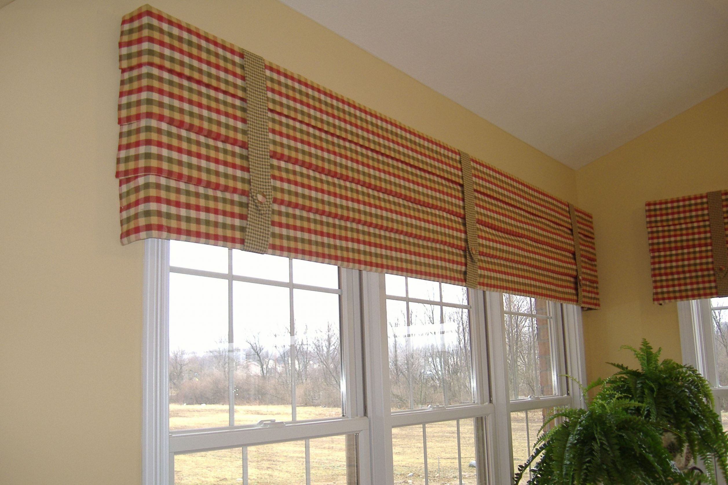 DH homes~ Model home sunroom hobbled roman mock valances with ..