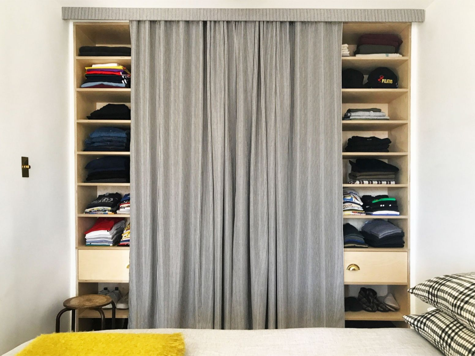 Ditch Your Closet Doors for a Tailored Curtain | Architectural Digest - closet valance ideas