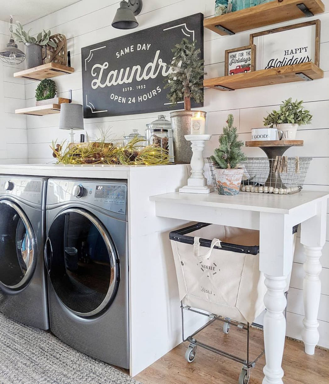 Farmhouse style laundry room with shiplap walls, open wood ..