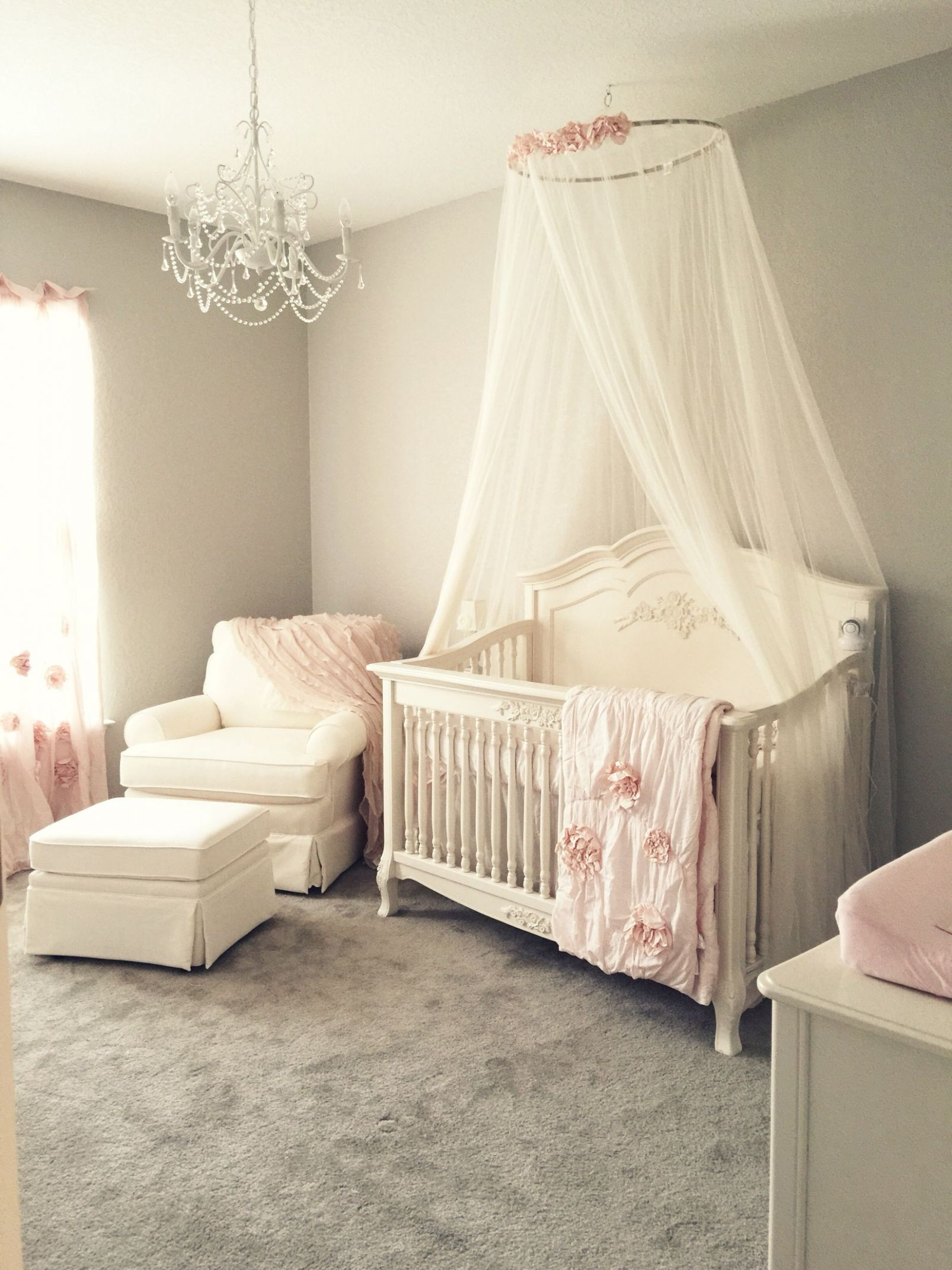 Girly pink blush nursery with chandelier, ivory rocker and glider ...