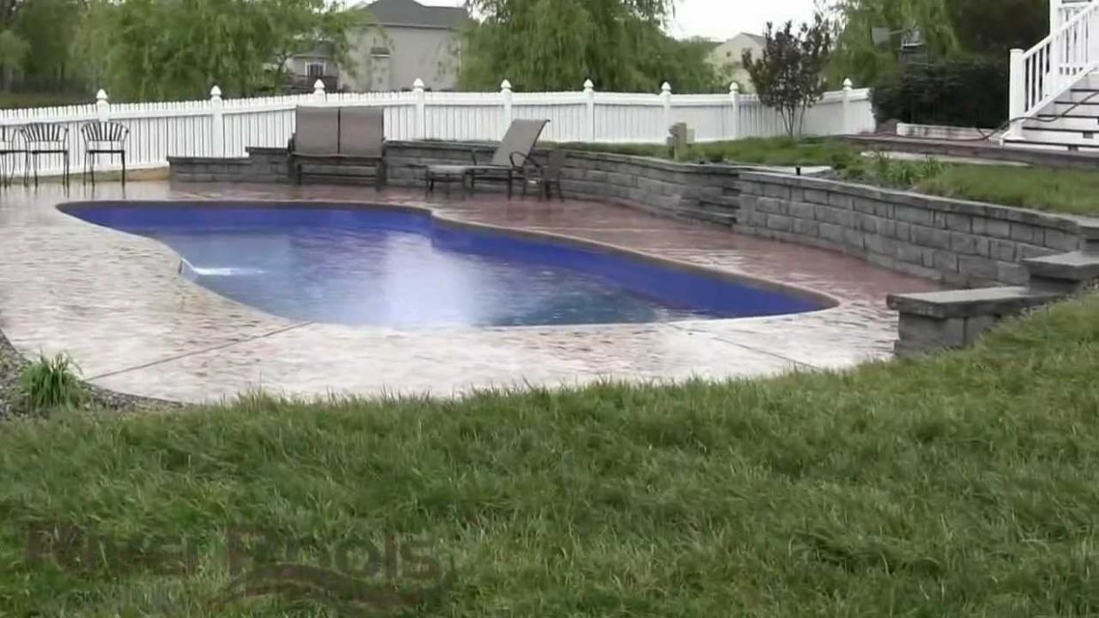 Gorgeous Fiberglass Pool w/ Retaining Wall: Solutions For Sloped Yards
