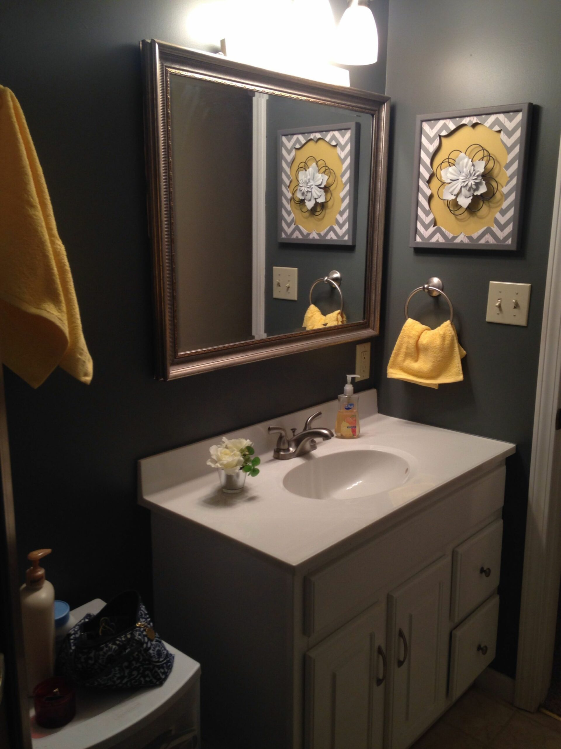 Grey and yellow bathroom. Needs a pretty floral shower curtain and ..