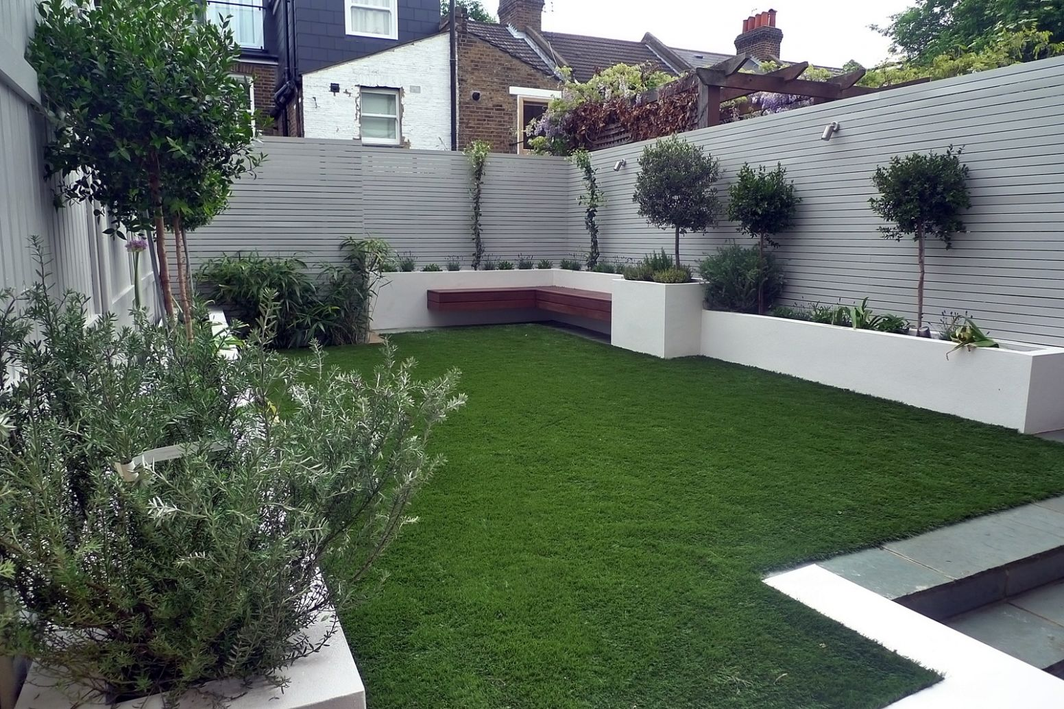 How to Create Backyard Privacy for Your Outdoor Haven - garden ideas grey fence
