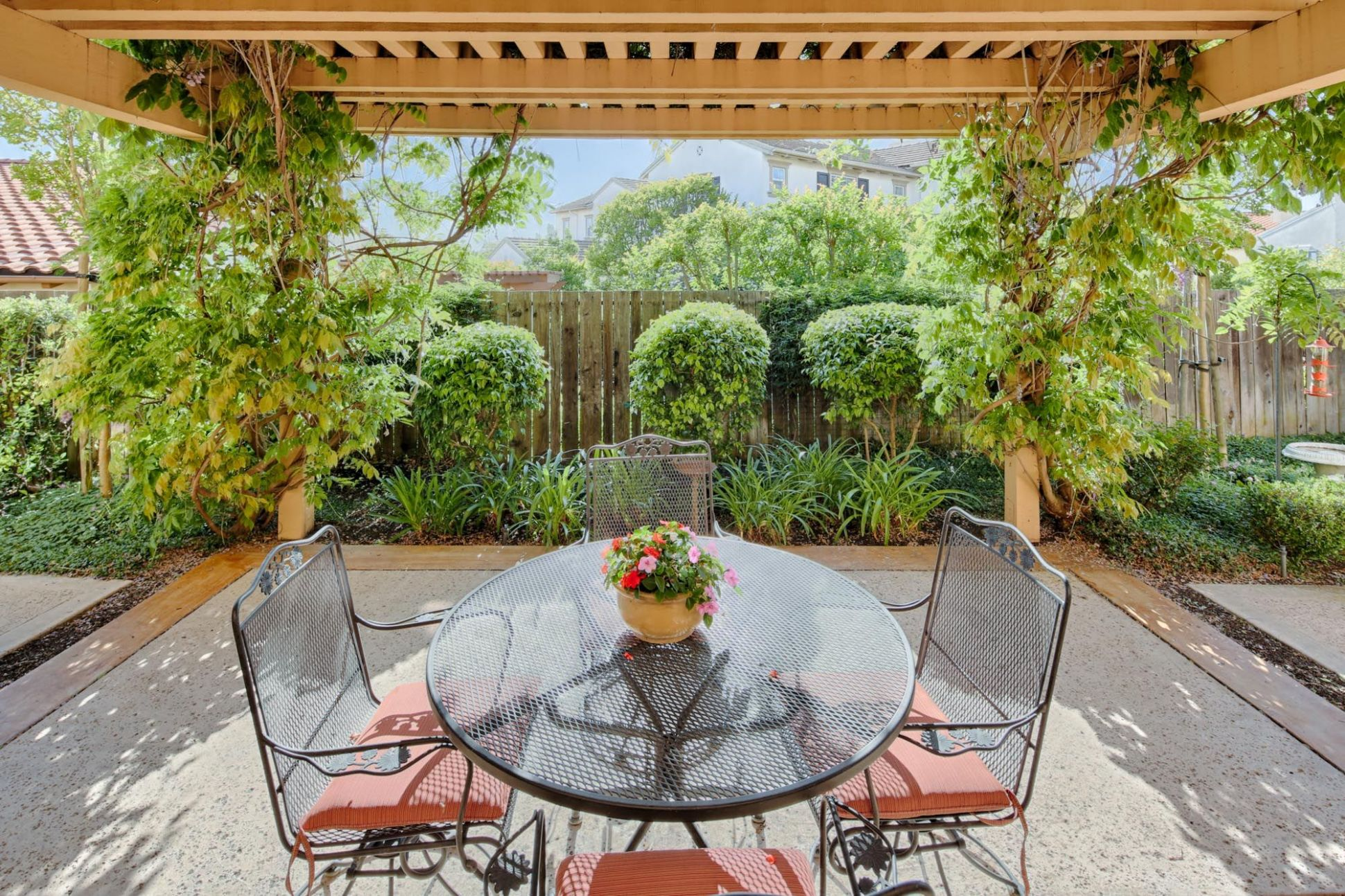 Imagine your morning coffee in this lush and quaint backyard ..