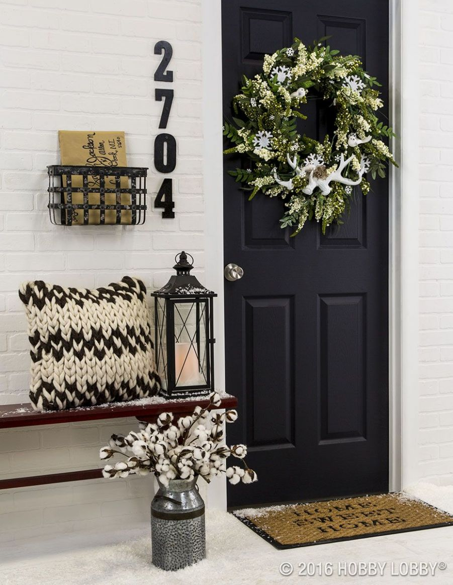 Incorporate front door decor that provides a welcoming energy to ...