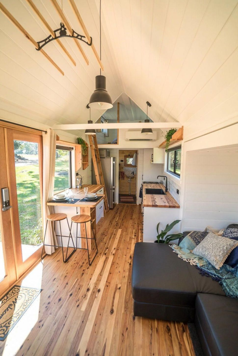 Inside the Sojourner are beautiful cypress pine floors and bench ...