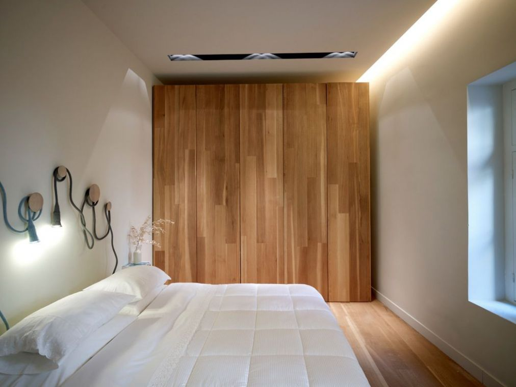 K-Studio sought to disguise much of the apartment's lighting and ...