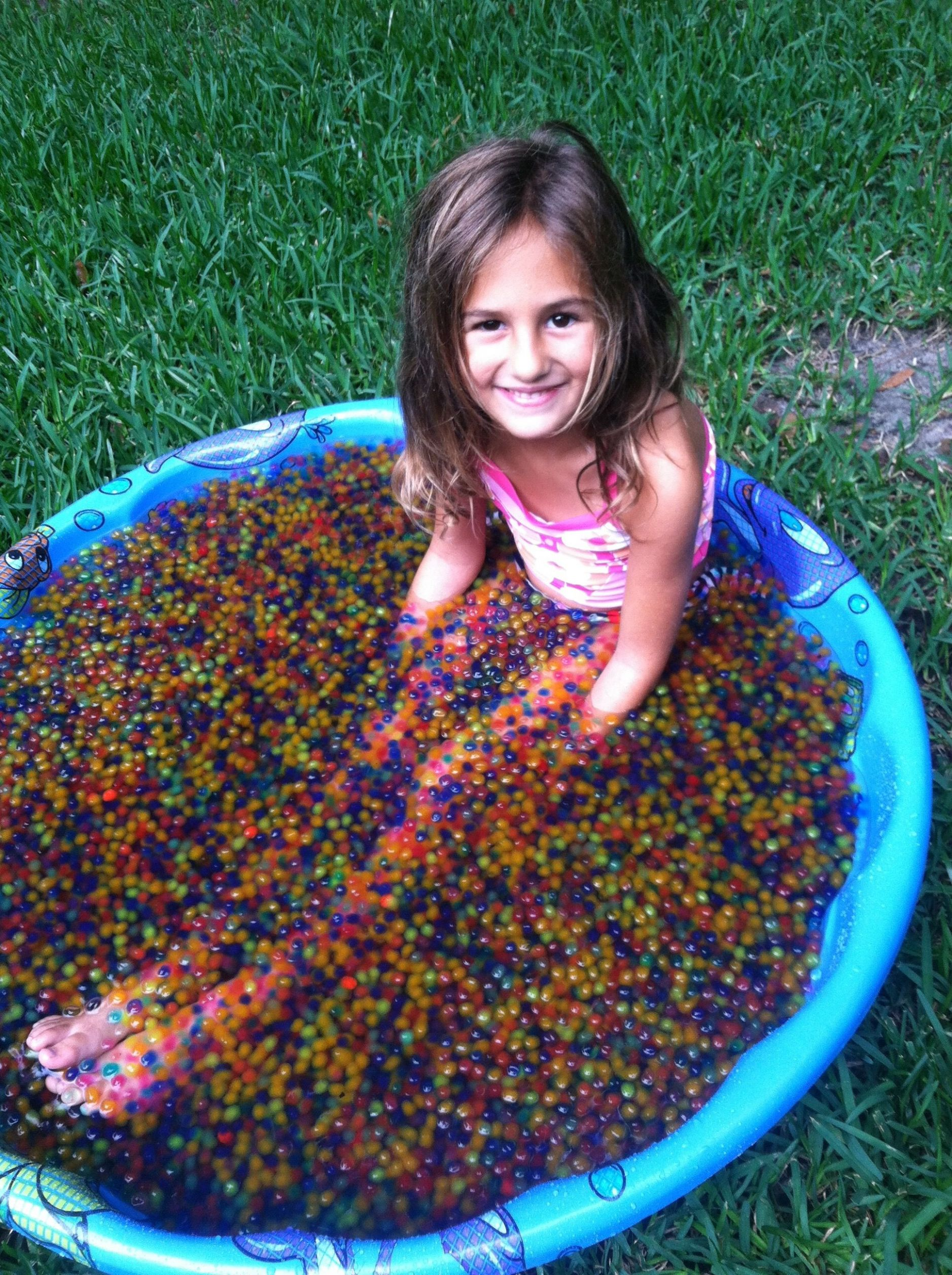Kiddy pool filled with water beads that expand--great for the kids ...