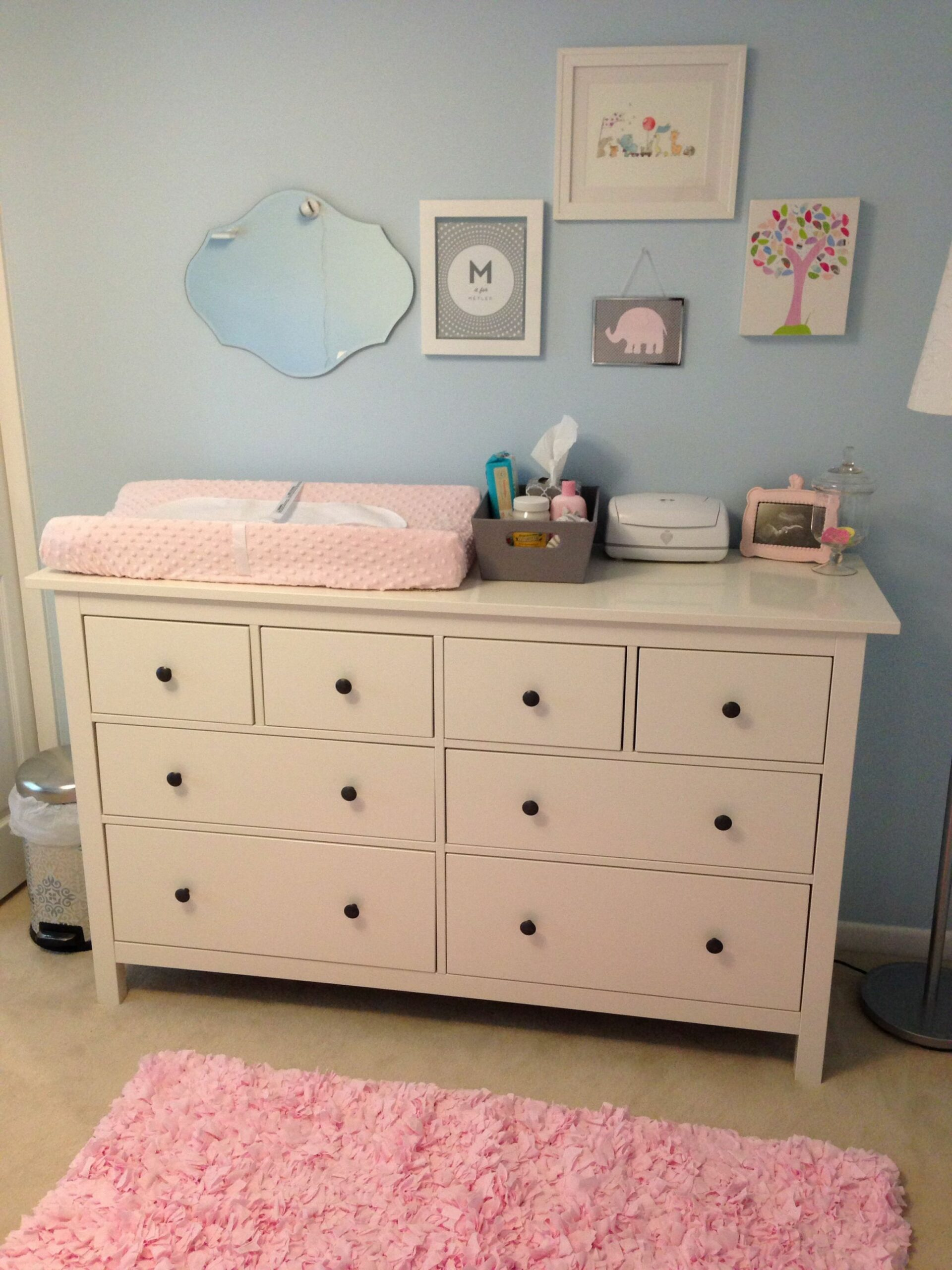 Light blue & pink nursery with ikea dresser as changing table ..