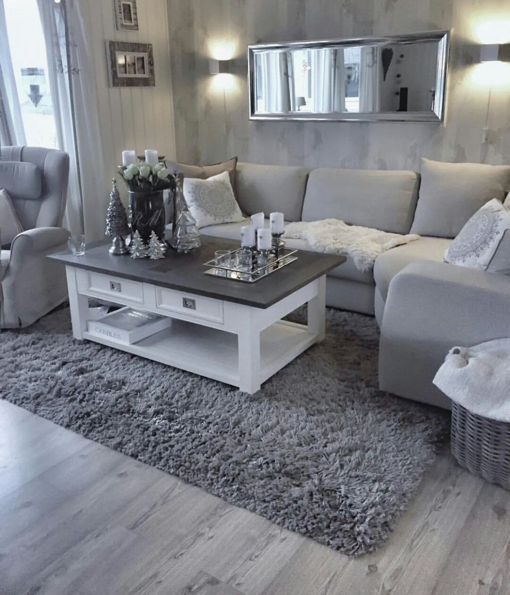 Light-grey sofa with two-tone white coffee table atop a darker ...