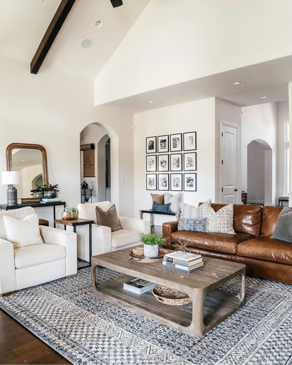 Love this open layout livingroom with off white walls and leather ..