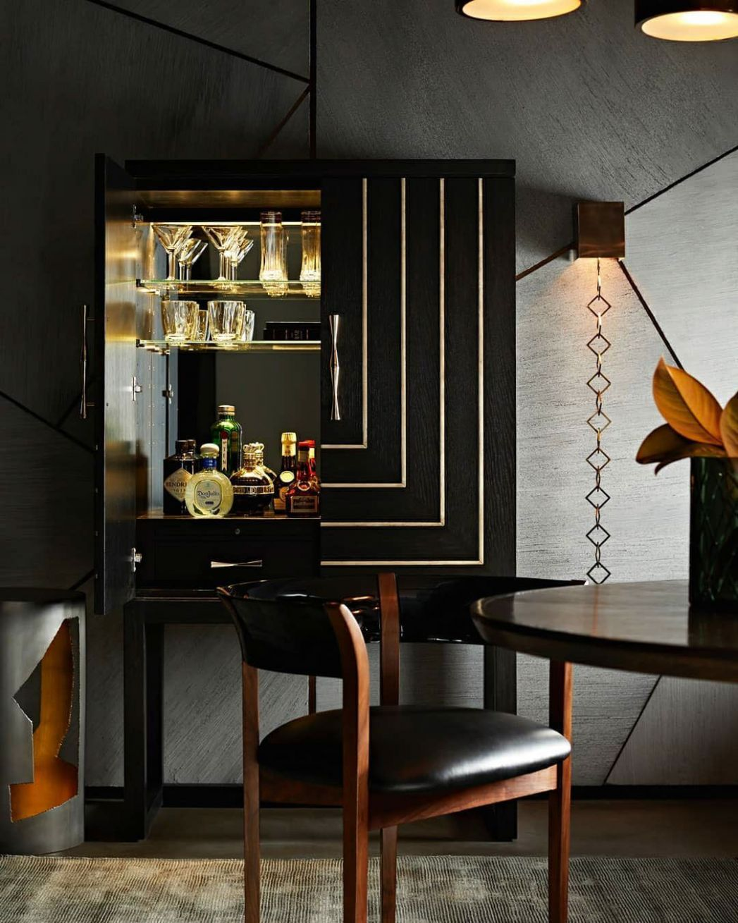 luxury interior setting featuring lavish bar cabinet; luxury ...