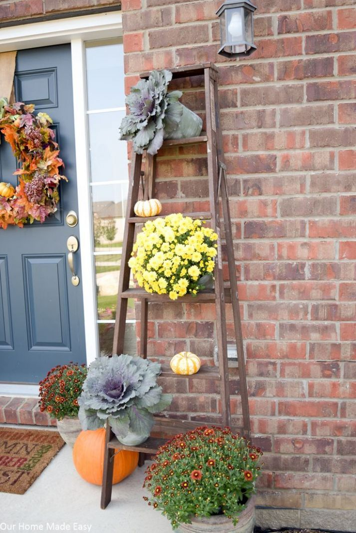 Our Rustic Fall Front Porch (With images)   Fall decorations porch - front porch ladder decor