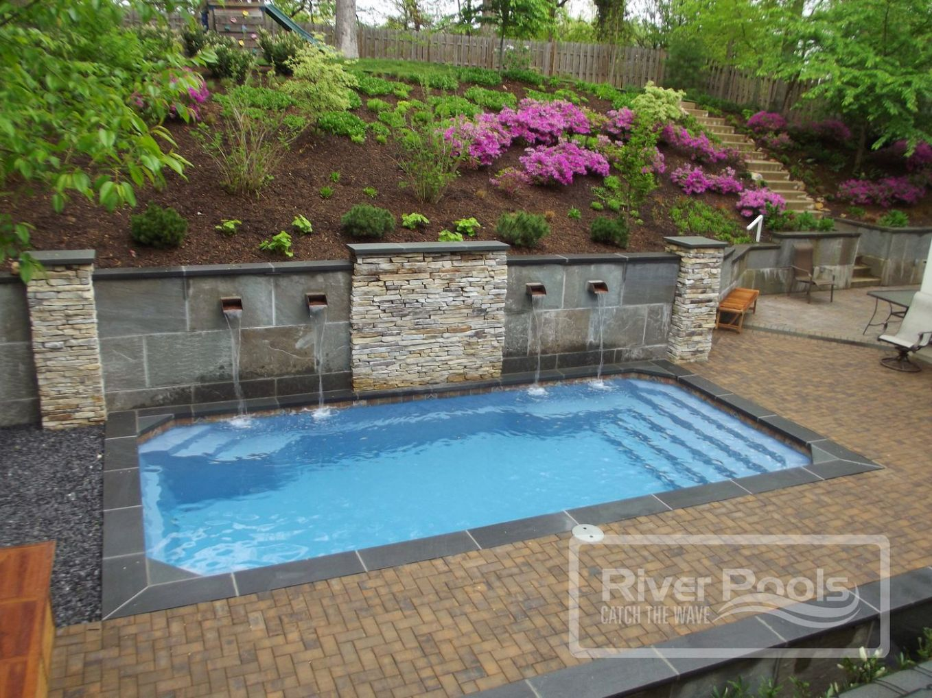 Pool Retaining Walls for Sloped Yards: Cost, Materials, and More - pool ideas with retaining wall